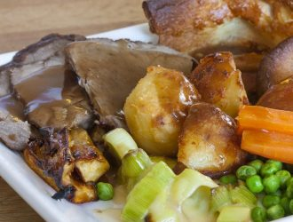 sunday roast dinner on an old wooden table